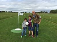 Family Round of Kick Golf for Two Adults and Two Children